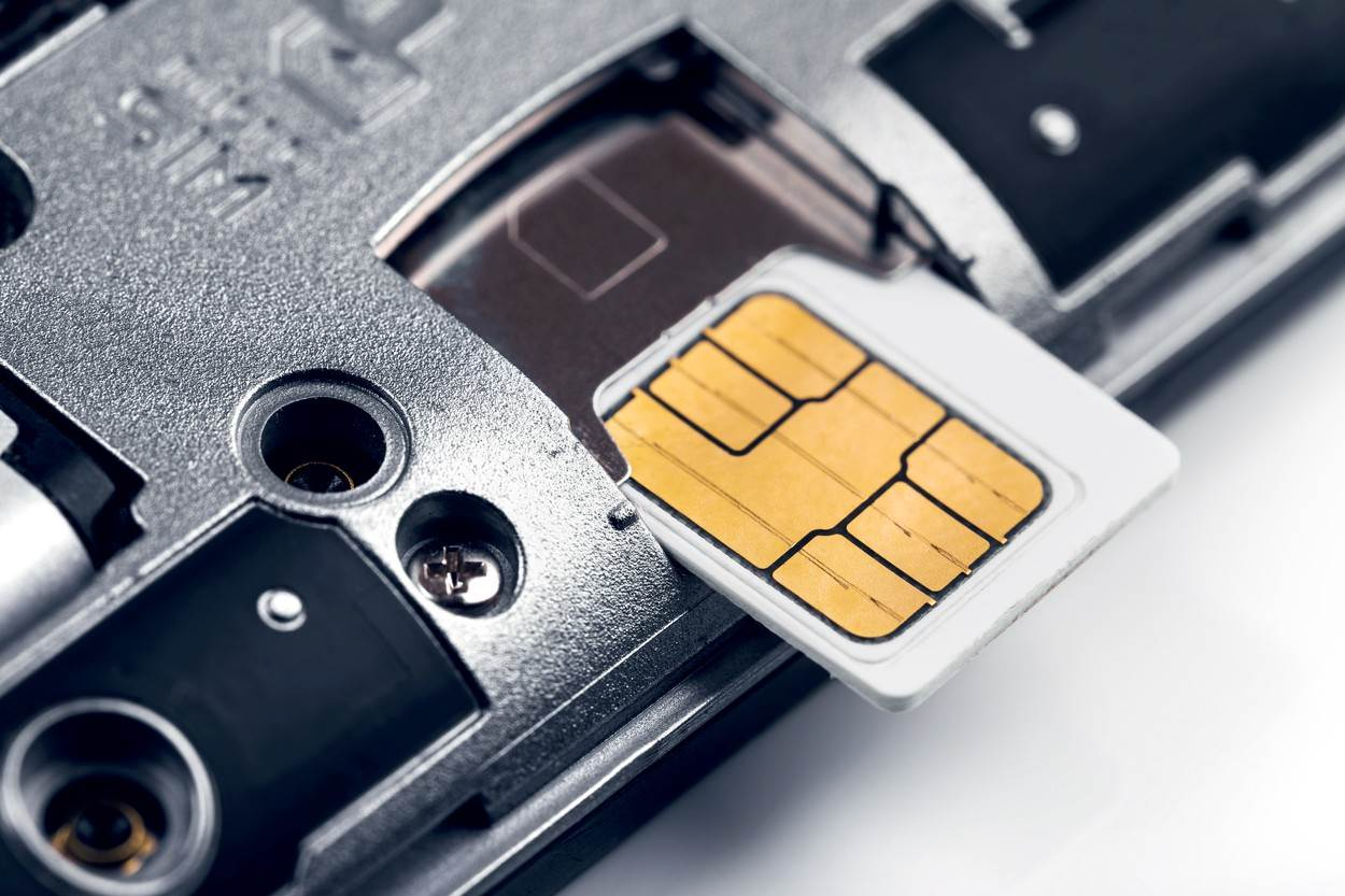 sim;card;phone;mobile;cell;communication;smart;smartphone;install;insert;4g;internet;prepaid;operator;technology;telephone;call;cellphone;service;chip;simcard;closeup;macro;connection;white;network;wireless;device;telecommunications