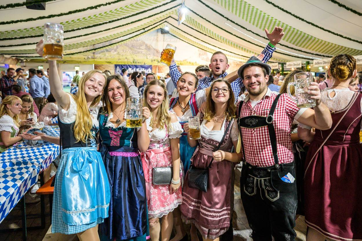 alcohol;alcoholic beverage;alcoholism;asia;asian;attraction;audience;autumn;background;band;bavaria;beer;carnival;celebrate;celebration;citizen;color;crowd;culture;drink;europe;festival;firmly;food;fun;german;germany;good;group;hacker;happiness;indoors;leisure;marquee;mood;move;munich;october;octoberfest;oktoberfest;party;people;pleasure;solid;state;tent;tourism;traditional;travel;vacation