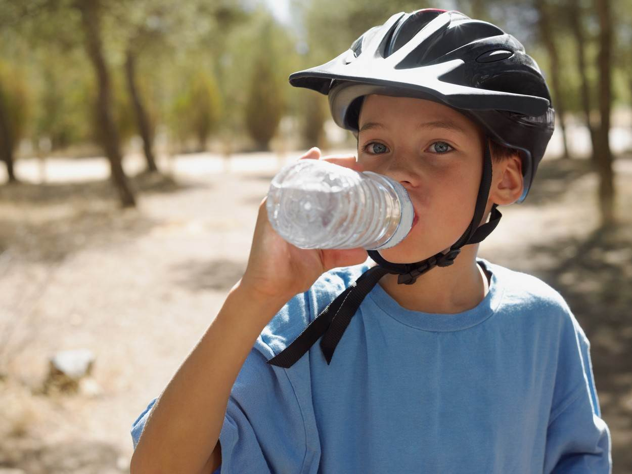 drinking;wearing;holding;cycling;looking at camera;differential focus;childhood;fitness;healthy lifestyle;refresh;February 2007 Release;tree;water bottle;child;10 to 13 years;caucasian ethnicity;male;boy;only one boy;one person;cyclist;spain;andalusia;outdoors;forest;summer;bicycle helmet;mineral water;sunlight;leisure;taking a break;vacation;only male;Cycling;Consuming Food;Drinking;Resting;Taking A Break;Holding;Caucasian Ethnicity;Child;Male;Boys;Cyclist;Childhood;Refreshment;One Person;Southern Europe;Iberian Peninsula;Spain;Andalusia;Looking At Camera;Camera Focus;Selective Focus;Tree;Drink;Cold Drink;Drinking Water;Mineral Water;Bottle;Water Bottle;Sports Clothing;Protective Sportswear;Bicycle Helmet;Symbol;Orthographic Symbol;Numeral;Woodland;Forest;Light;Sunlight;Outdoors;Summer;Leisure;Lifestyles;Healthy Lifestyle;Fitness;Travel;Vacations;Boy;Wearing;Non-Alcoholic Drink