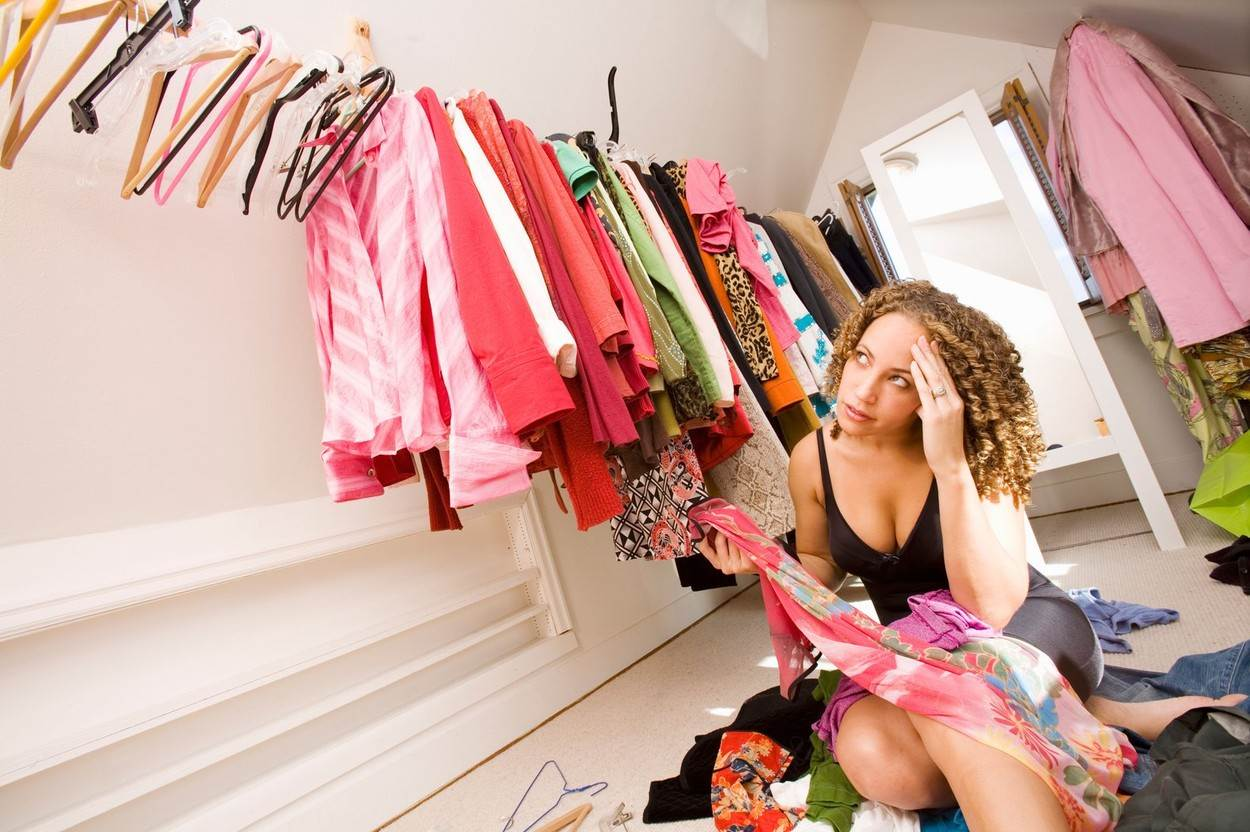 closet;getting dressed;looking;woman;1;abundance;caucasian;choice;clothes hanger;clothing;color;confusion;deciding;domestic life;excess;fashion;hanging;horizontal;inside;leaning;lifestyle;looking up;mixed race person;only women;NOT_EDITORIAL_ONLY