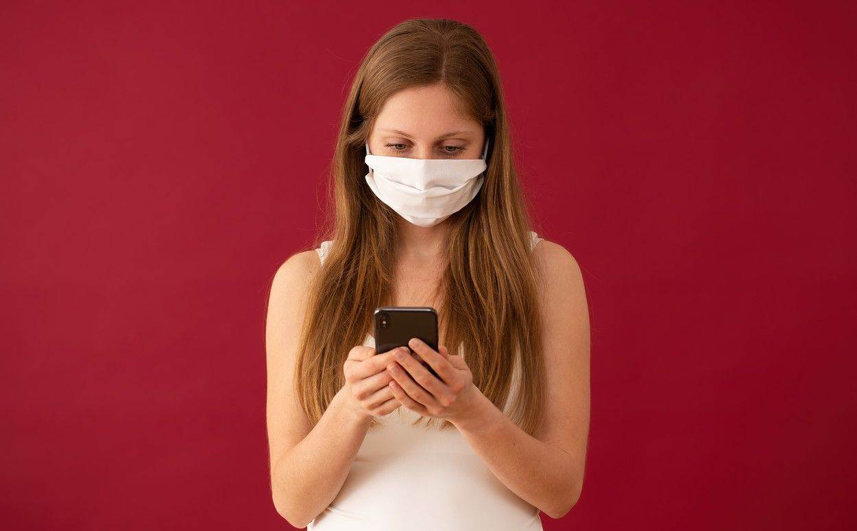 woman;iphone;face mask;message;love;valentine;girl;online dating;female;red;mobile;background;texting;lady;smartphone;feminine;sending;model;phone;mistress;adult;person;human;figure;virus;epidemic;hygiene;protection;safety;flu;medical;mask;pollution;care;allergy;disease;infection;illness;prevention;respiratory;surgical;filter;medicine;breathing;health care;mouth;pandemic;surgical mask;coronavirus;14february