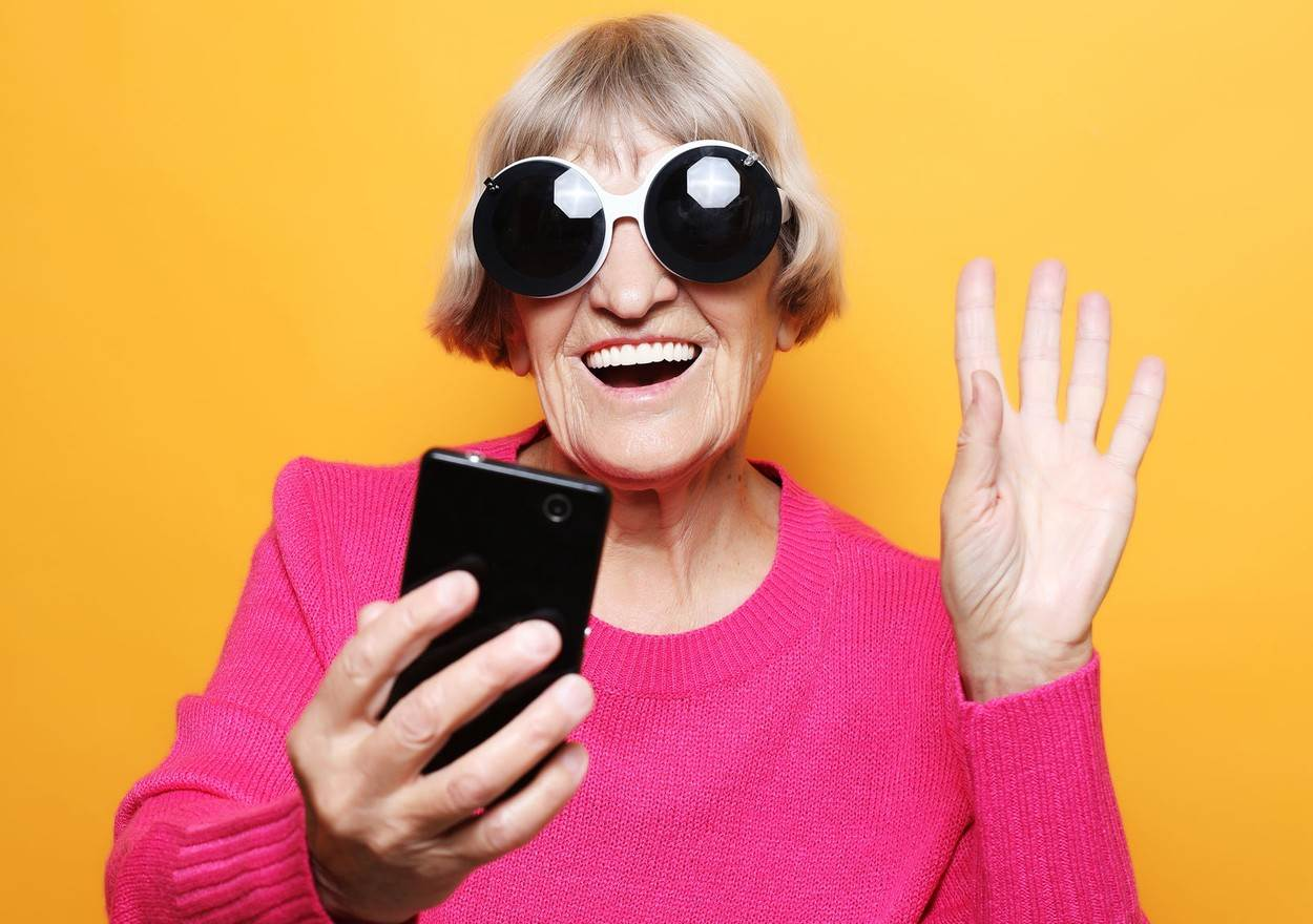adult;aged;attractive;background;beautiful;beauty;casual;caucasian;chat;cheerful;communication;confident;elderly;face;family;fashion;female;friendly;gadget;grandma;grandmother;gray;hair;happy;healthy;lady;lifestyle;looking;mature;message;mobile;modern;mom;mother;old;one;people;person;phone;portrait;pretty;retirement;senior;smart;smile;technology;white;wife;woman