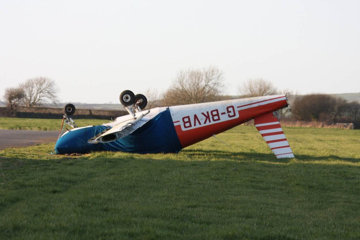 Airplane crash upside down plane airfield gale air;Airplane crash upside down plane airfield gale air wind aircraft air traffic pembrokeshire west Wales aerodrome field blown accident safety;NOT_EDITORIAL_ONLY