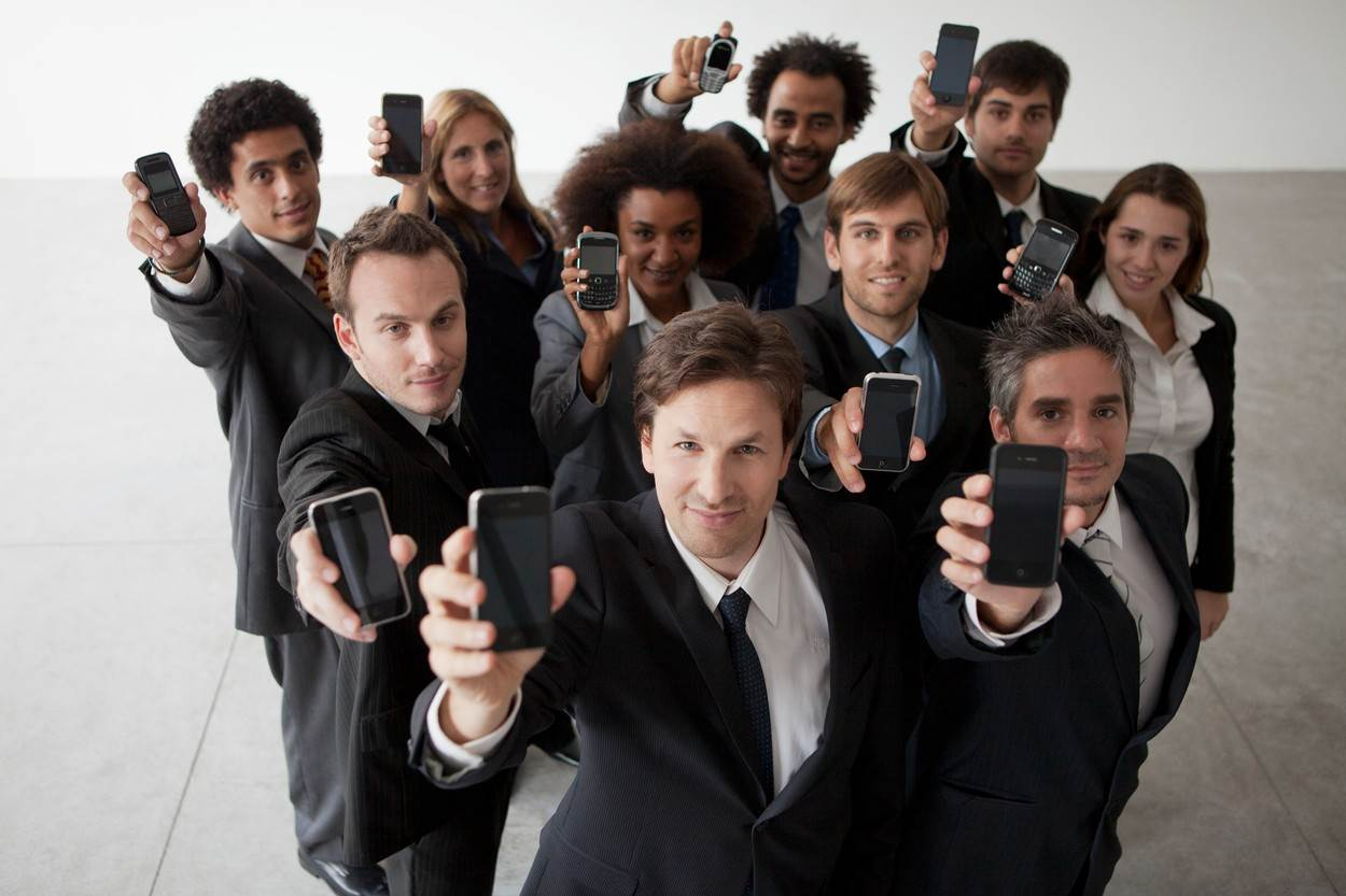 executive;wireless technology;choice;cell phone;holding up;community;businesswoman;businessman;mid-adult woman;young woman;medium group of people;35-39 years;30-34 years;25-29 years;20-24 years;man;adults only;woman;young adult;mid-adult;adult;mid-adult man;young man;abundance;connection;mobility;telecommunications;communication;smartphone;full suit;business attire;studio shot;looking at camera;together;standing;cropped;front view;high angle view;selective focus;color image;communities;part of;partial view;cell phones;choices;executives;adults;young adults;women;men;young women;young men;mid-adult men;mid-adults;full suits;smartphones;businessmen;businesswomen;connections;color images;cell;mobile phone;businessperson;eyes on camera;view from above;elevated view;twenties;20s;early 20's;late 20's;early 30's;late 30's;medium group of persons;thirties;30s;telecom;portable;connectivity;copiousness;a lot;abundant;plentiful;iPhone;connexion;colour image;cells;mobile phones;businesspeople;wireless technologies;looking at cameras;high angle views;connexions;smart phones;iPhones;mid adults;colour images;studio shots;mobile;looking to camera;standing up;overhead view;from above;from the front;young person;age 20-25;early twenties;age 25-30;late twenties;age 30-35;early thirties;age 35-40;late thirties;mid adult person;just adults;copious;plenty;plentious;differential focus;eyes on the camera;looking at the camera;high angle;high-angle view;20's;early 20s;late 20s;early 30s;late 30s;mid adult woman;mid adult man;mid adult men;mid adult;30's;mid-adult person;alot;smart phone;studioshot;studio-shot;photoalto