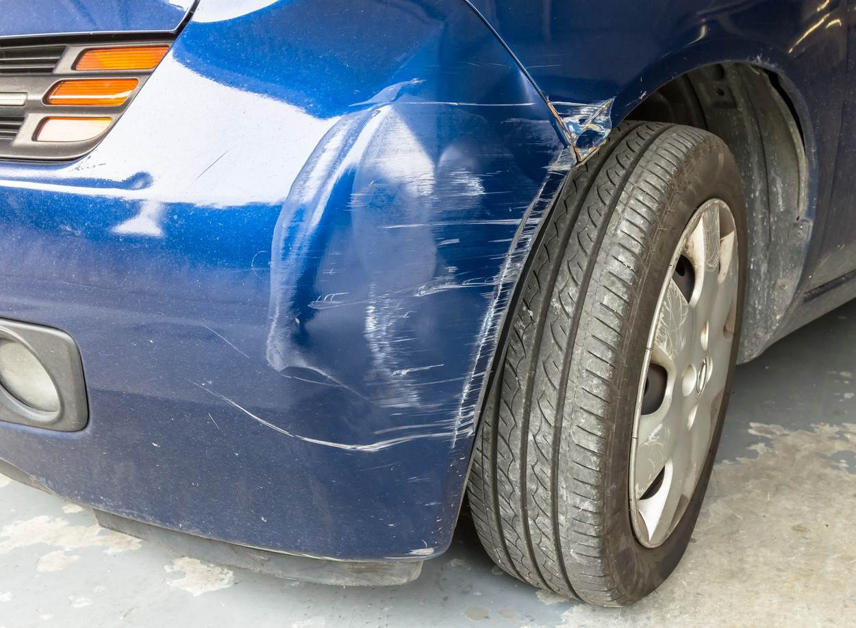 accident;automobile;automotive;background;blue;body;bumper;business;car;closeup;color;damage;damaged;design;dirty;front;insurance;light;metal;motor;old;repair;road;ruined;rust;safety;street;swiping;texture;traffic;transportation;vehicle;vintage;white