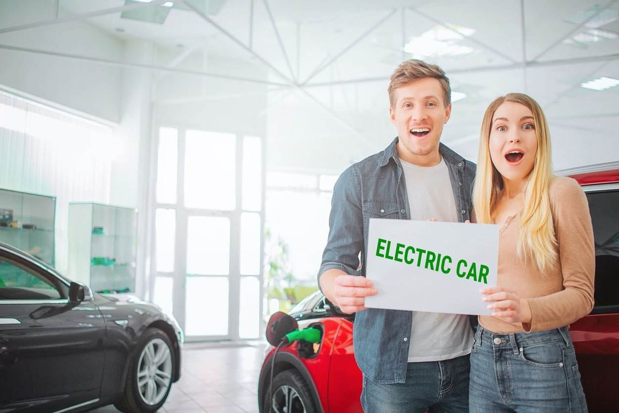 alternative;auto;automobile;automotive;battery;buy;car;clean;concept;couple;credit;driver;eco;ecofriendly;ecological;ecology;electric;electricity;electro;energy;engine;environment;environmentally friendly vehicle;green;hire purchase;hybrid;industry;innovation;installment plan;man;nature;plug;pollution;power;protect;purchase;recharge;rechargeable;recharging;renewable;safety;sale;salon;socket;station;technology;transport;trend;vehicle;woman