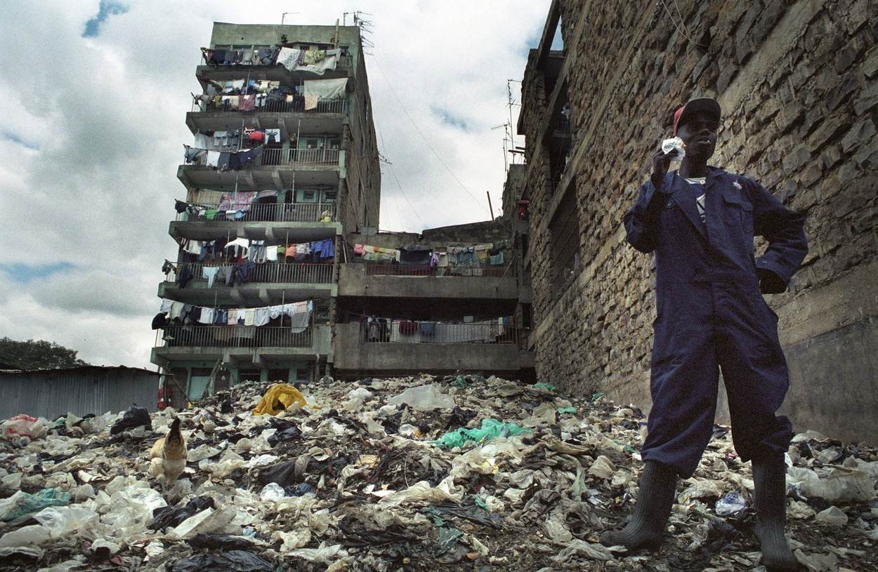 Africa Urban Housing Architecture Slums Poverty;Africa Urban Housing Architecture Slums Poverty garbage dump yard misery stink smell worker break stink stench stinking unwholesome dirty food sandwich dirty jobs occupation ghetto africa african people disgusting weird unusual jeans overall boots;NOT_EDITORIAL_ONLY