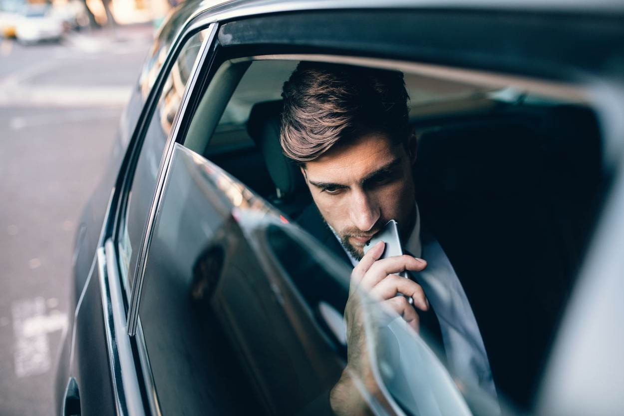 backseat;black;business;businessman;car;caucasian;city;corporate;handsome;inside;journey;life;lifestyles;males;man;men;mode;moving;one;passenger;pensive;people;person;real;serious;sitting;taxi;thinking;transport;transportation;travel;travelling;uber;vehicle;window;young