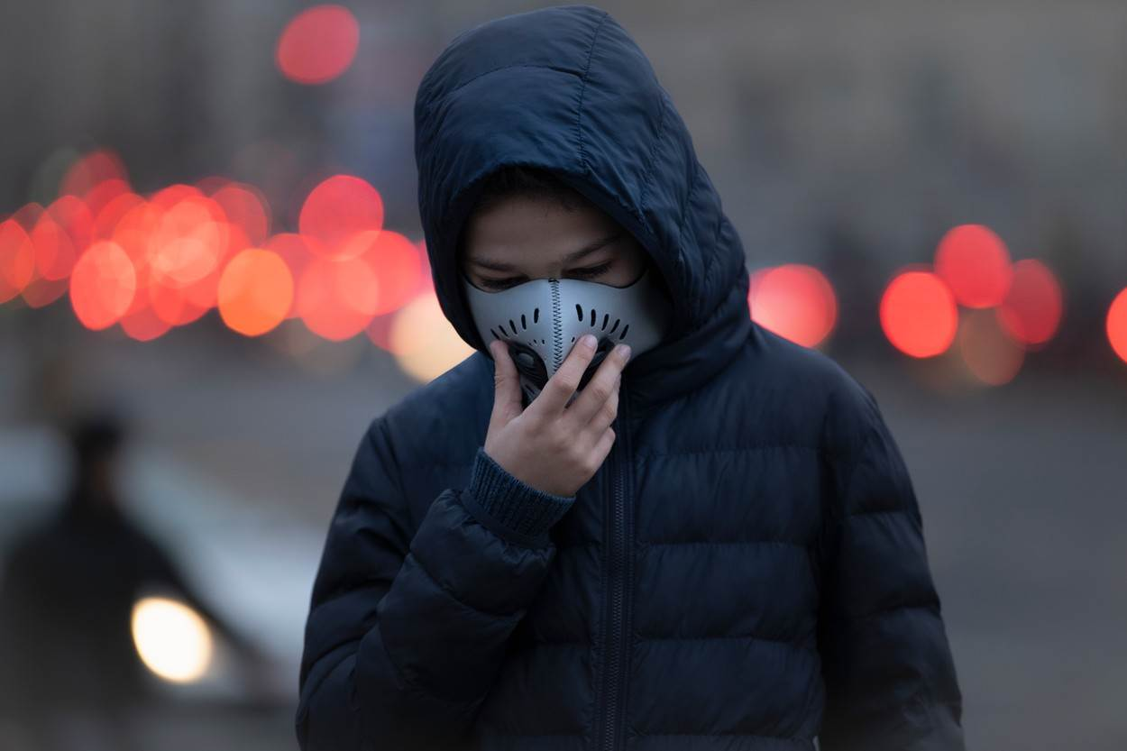 young;person;child;pollution;anti;polluted;air;city;street;global;warming;smoke;breathing;difficulties;quality;poor;boy;sad;traffic;lights;teenage;one;category_code_healthcare
