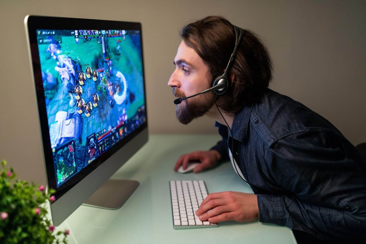 european;game;guy;caucasian;interactive;keyboard;keys;indoor;male;multiplayer;computer;internet;technology;background;silhouette;sport;man;gamer;sitting;headphones;screen;monitor;illuminated;headset;gaming;desktop;pc;room;competition;display;fun;professional;victory;video;winner;virtual;watch;young;wireless;win;player;videogame;play;visual;online;backlit;battle;participation;digital;entertainment;people;NOT_EDITORIAL_ONLY