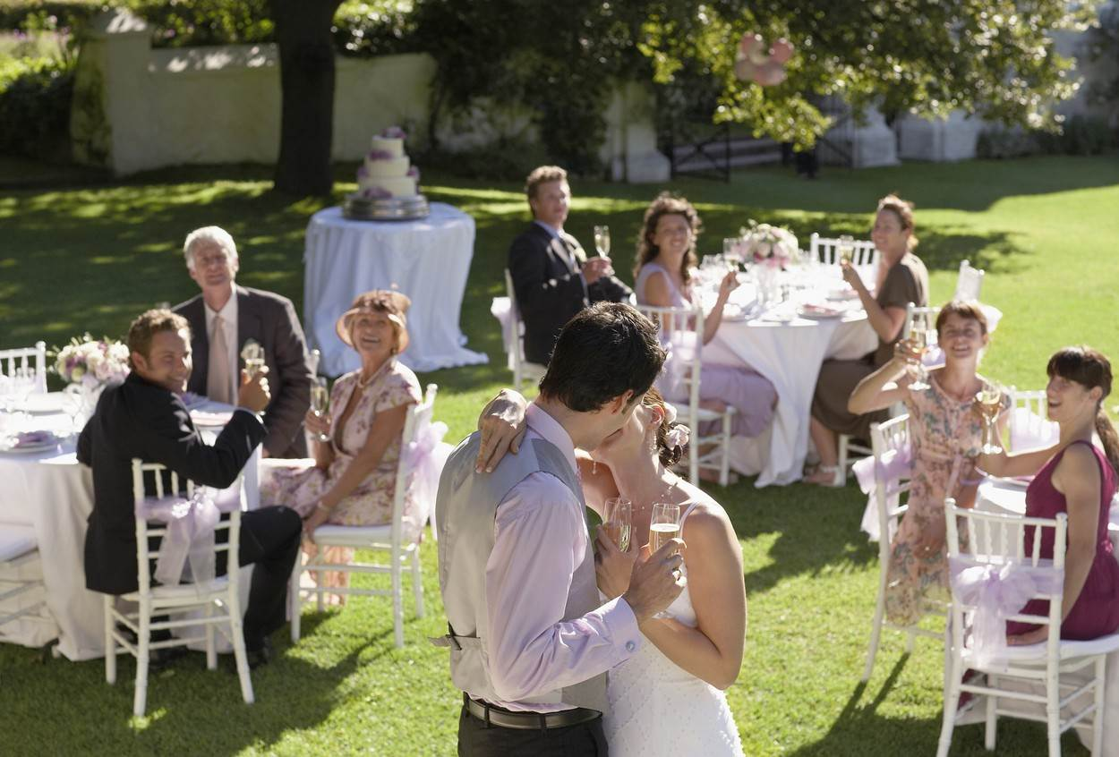 WEDDING;MODEL;RELEASED;MID;ADULT;BRIDE;AND;GROOM;IN;GARDEN;AMONG;GUESTS;HOLDING;WINEGLASSES;KISSING;OUTDOORS;DAY;STANDING;AGE;RANGE;GROUP;OF;PEOPLE;ENJOYMENT;COUPLE;SMILING;TOGETHERNESS;HAPPINESS;SUMMER;TWO;WITH;OTHERS;FORMAL;WEAR;DRESS;LIFE;EVENTS;20S;GUEST;TABLE;WAISTCOAT;GRASS;RECEPTION;LAWN;CAUCASIAN;OUTSIDE;WINEGLASS;PARTY;SOUTH;AFRICA;CAPE;TOWN;APPEARANCE;MEDIUM;25-30YEARS;FIRST;DANCE;STOCK;MODEL RELEASED;NOT-PERSONALITY;8879304