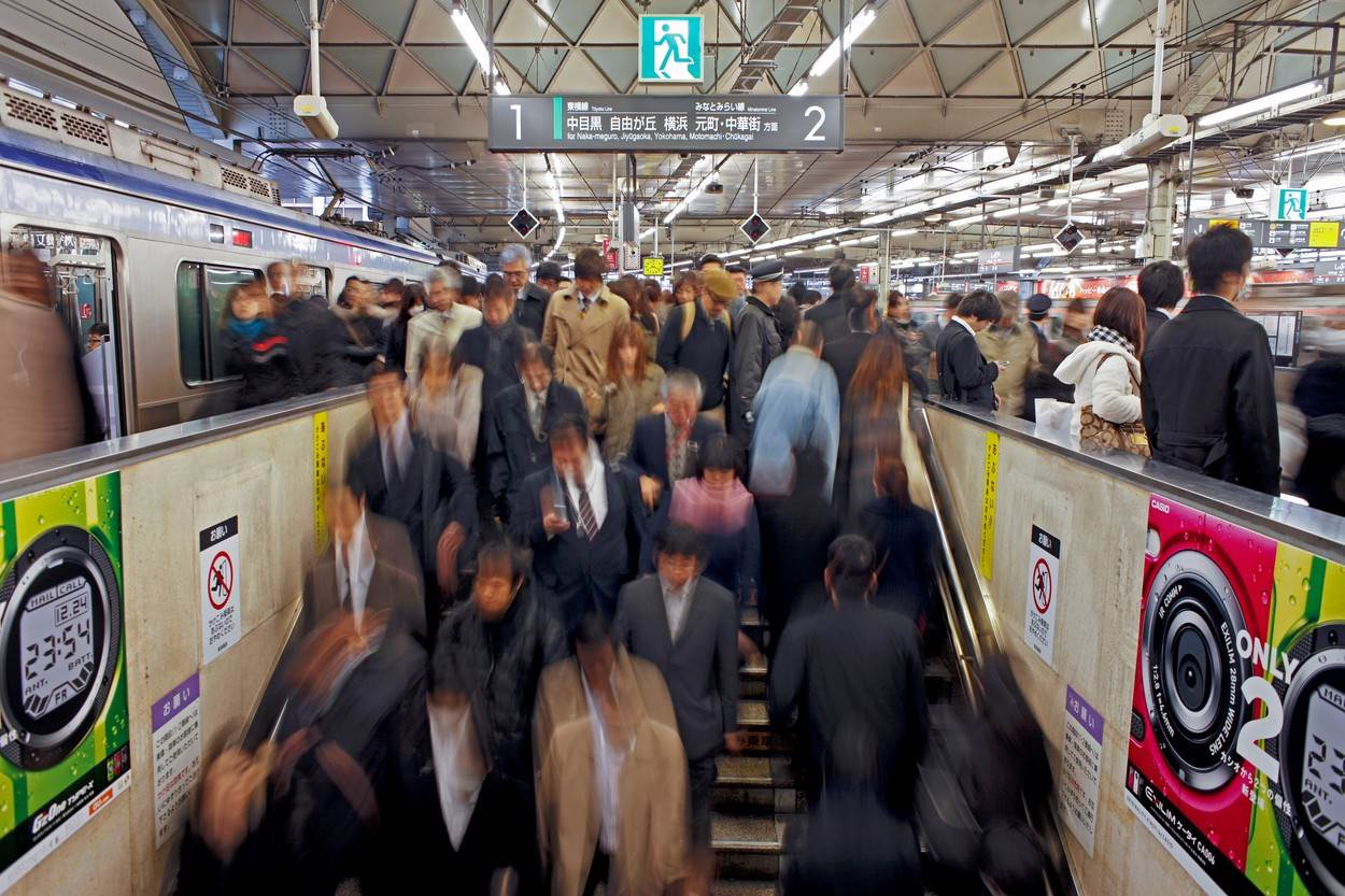 color image;photography;large group of people;people;scenic;transport;blurred;motion;commuting;commuter;train station;busy;indoors;scenics;travel;travel destinations;horizontal;blurred motion;subway;train;transportation;Commuters;Shibuya Station;rush hour;Shibuya District;Tokyo;Japan;Asia;crowd;crowded;steps;stairs