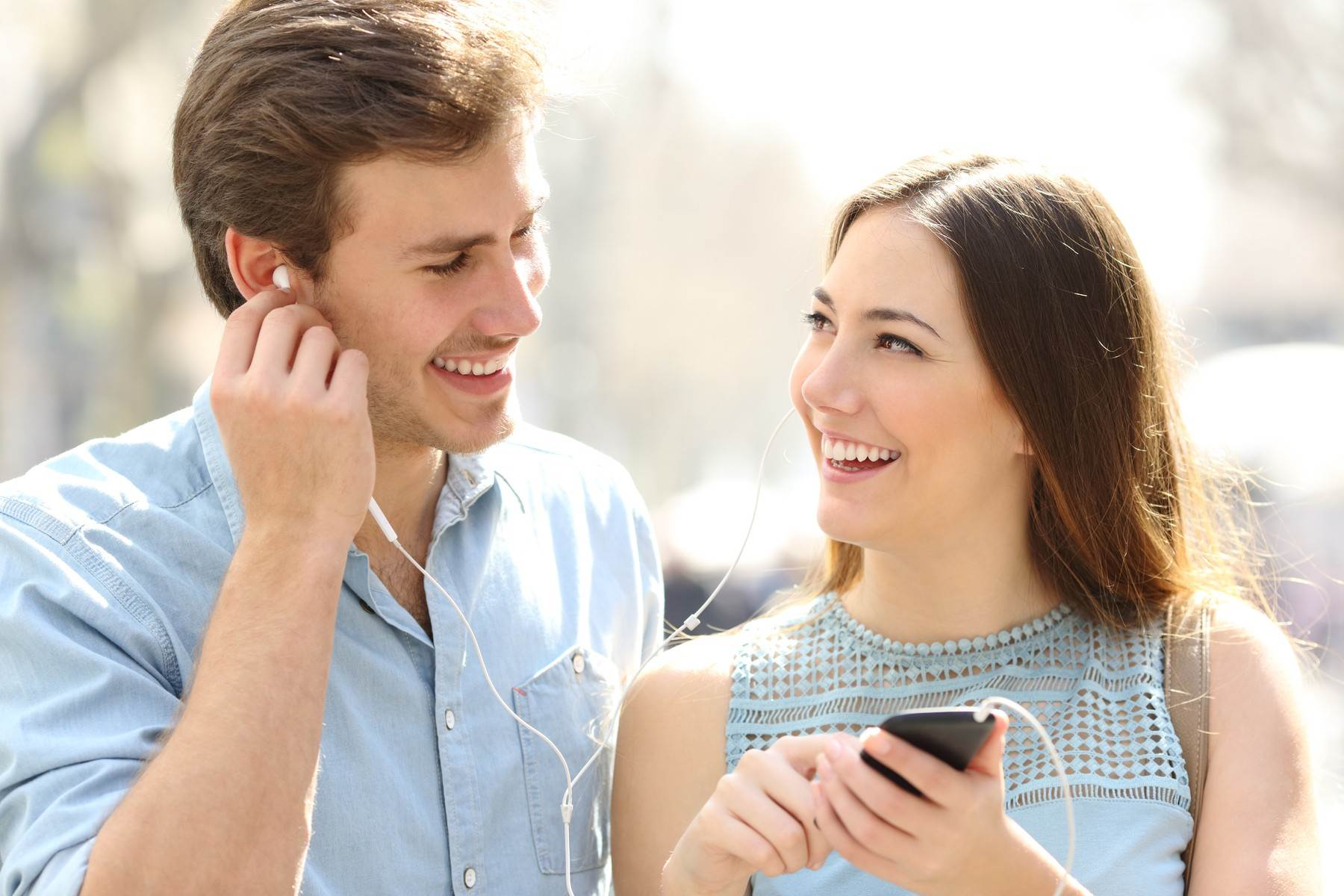 music;listen;listening;couple;headphones;earphones;phone;mobile;friends;people;smartphone;ear;happy;enjoying;love;song;teens;flirting;date;dating;girl;sharing;shared;using;earbuds;hearing;man;share;outdoor;lifestyle;facing;looking;each;other;funny;buds;young;city;street;urban;family;woman;laughing;outside;streaming;showing;flirt;falling;inlove;romance;boy;romantic;cell;cellphone;smart;sound;audio;adults;2;fun;teenagers;teenage;front;view;musical;meeting;cellular;walking;downloading;checking