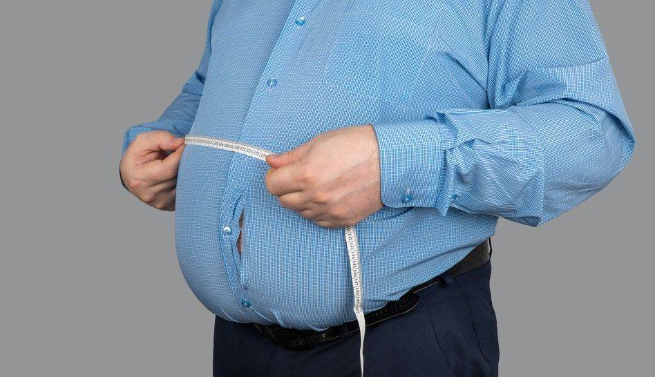 abdomen;adult;background;belly;big;body;calorie;cellulite;centimeter;diet;dieting;disease;excess;fat;fatness;fatty;figure;fitness;gluttony;guy;hand;health;human;isolated;lifestyle;losing;loss;male;man;measure;measurement;nutrition;obese;obesity;overeating;overweight;person;problem;shape;size;slimming;stomach;tape;thick;torso;tummy;unhealthy;waist;waistline;weight