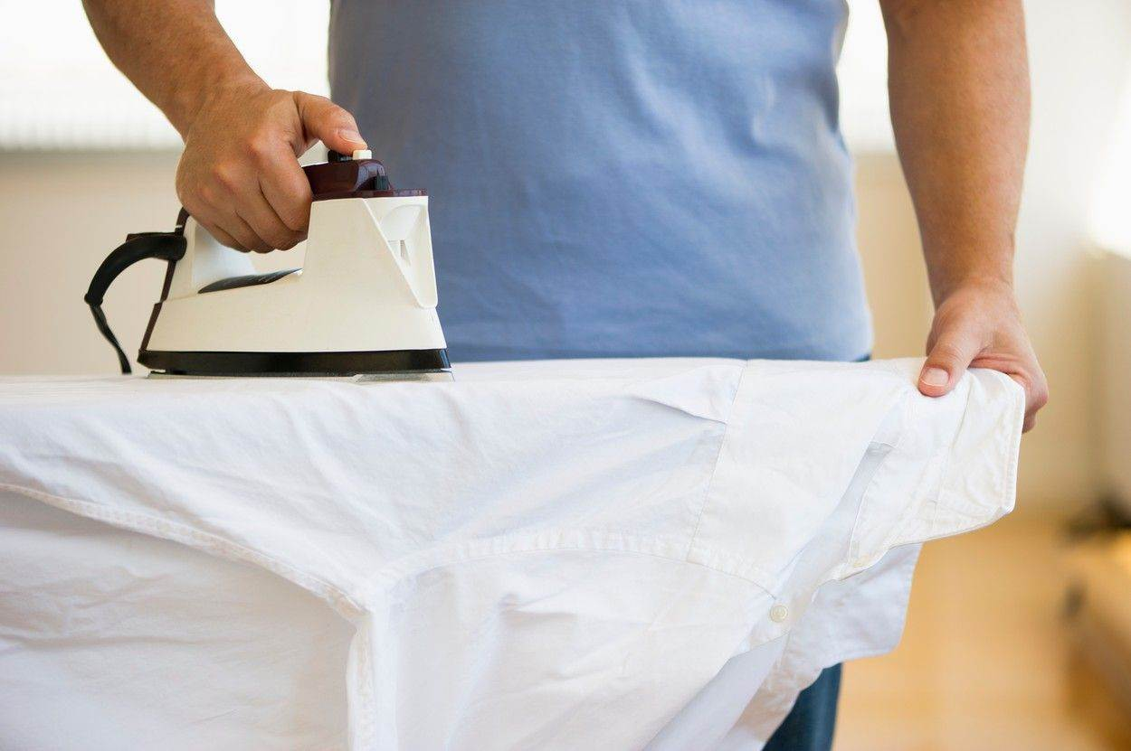 Ironing;Domestic Chores;Business Shirt;Hand;Chores;Holding;Domestic;Domestic Life;Shirt;At Home;Horizontal;Indoors;Day;Close-Up;Cropped;Mid Section;50-54 Years;One Person;One Mature Man Only;Home;House;Daytime;One Person Only;Man;Male