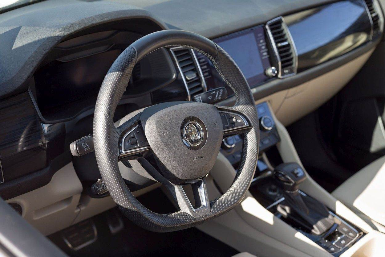 auto;automatic transmission;automobile;automotive;brown wood;bussines;car;chrome;climate;control;coupe;cruise;dashboard;display;editorial;equipment;horizontal;indicator;indoors;industrial;inner trim;interior;interior trem;izhevsk;kodiaq;leather;luxury;modern;motor;multimedia;new;nobody;onboard computer;plastic;russia;sedan;skoda;speedometer;steering wheel;switch;system;technology;transport;transportation;vag;vehicle;volkswagen auto group